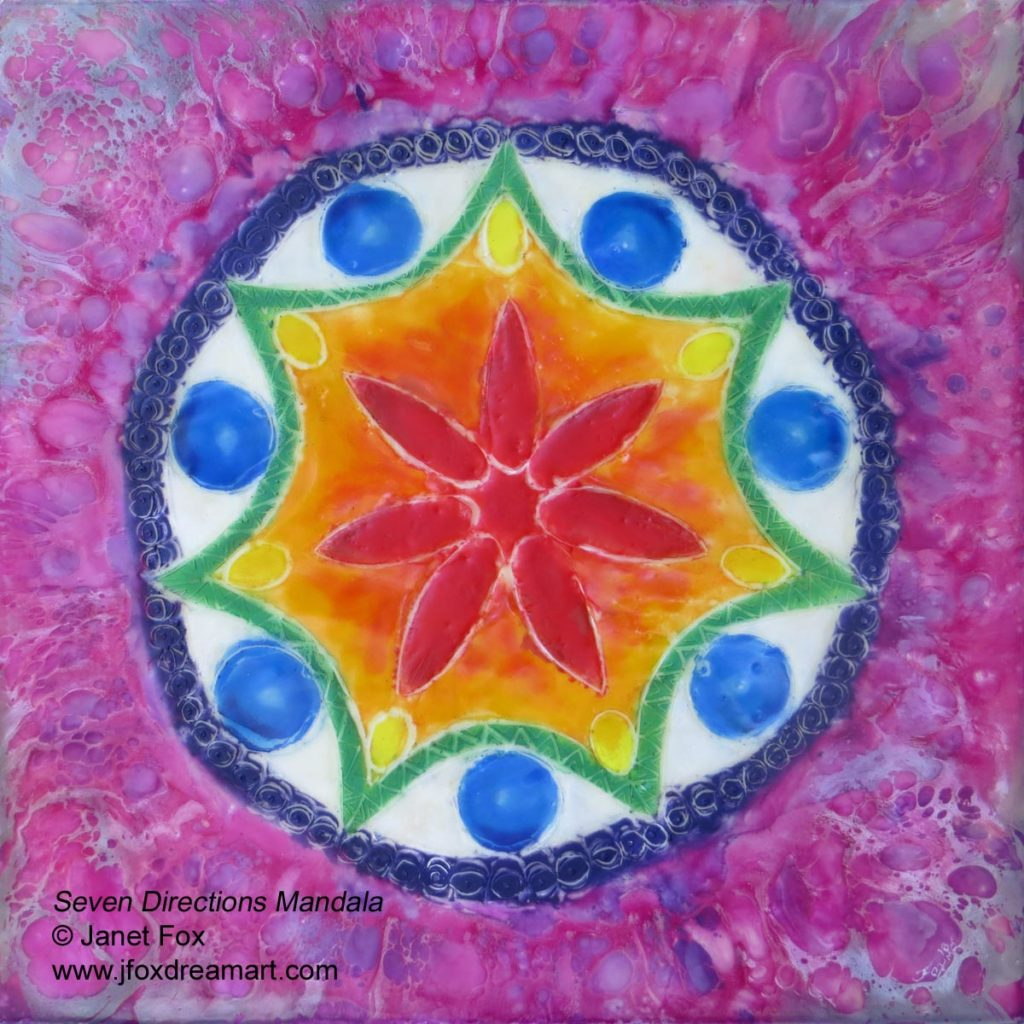 "An encaustic mandala painting ""Seven Directions Mandala"" by Janet Fox with rainbow colors"